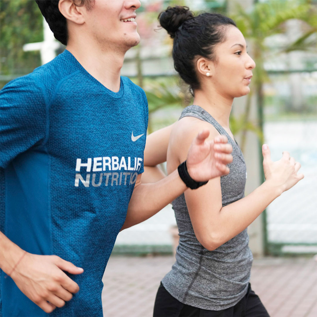 herbalife nutrition coach and his customer jogging together outdoors