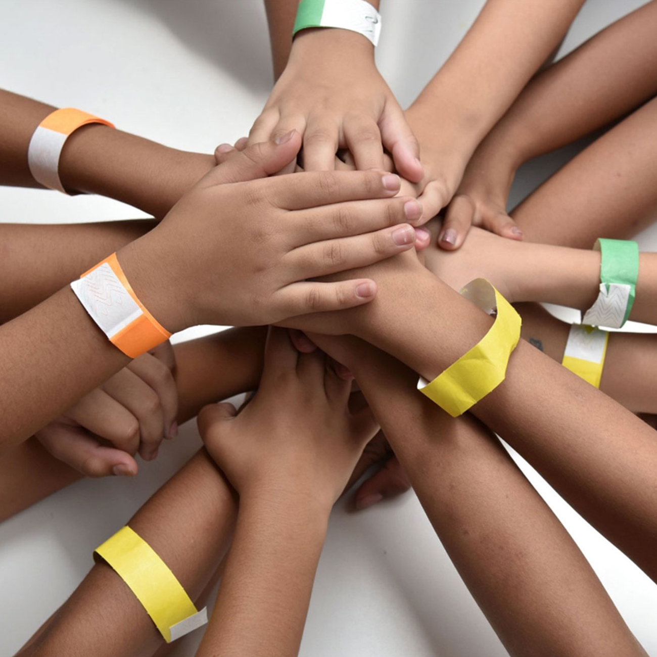 herbalife nutrition foundation group of children with hands stacked on top of each other